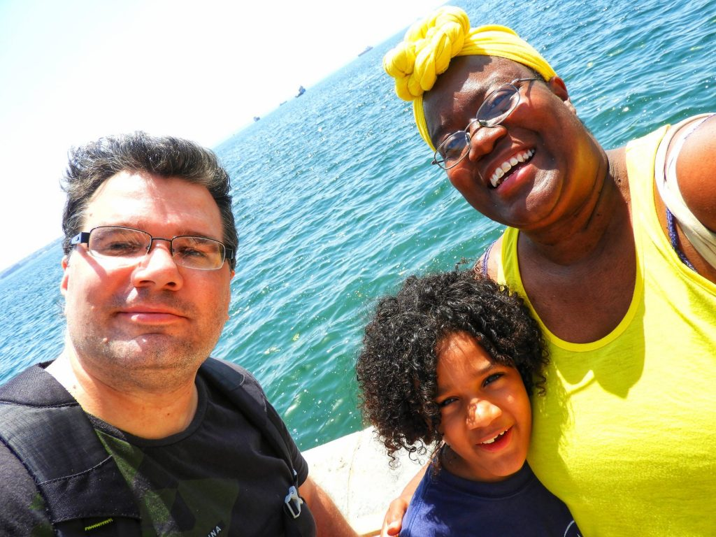 Head Chef Karen M. Ricks and family on a boat while traveling the world full-time